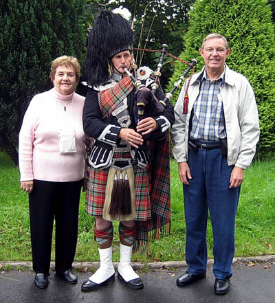 Ferrell and Elizabeth and a Scottish Bagpiper at Inveraray.