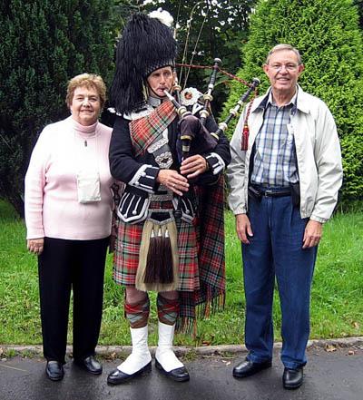 Ferrell and Elizabeth and a Scottish Bagpiper at Inveraray.