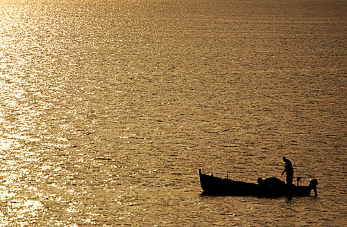 A fisherman on the Sea of Galilee at sunrise. Photo by Ferrell Jenkins.
