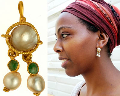 The earring and a model displaying it. IAA Photos.