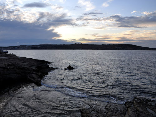 The rugged coast of St. Paul's Bay at Sunset. Photo by Ferrell Jenkins.
