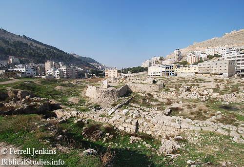 Shechem in the valley between Mount Gerizim & Mount Ebal.