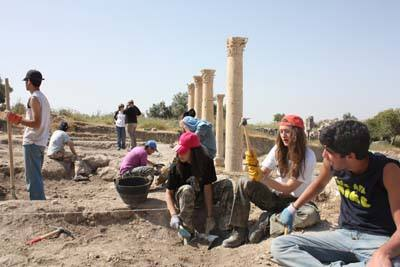 Students from the International Academy in Amman work at Um Qais. Photo by Taylor Luck, Jordan Times.
