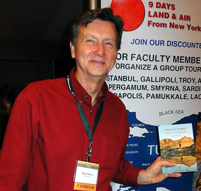 Mark Wilson shows his new book at SBL in Atlanta. Photo by Ferrell Jenkins.