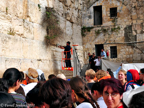 Women watch at the Western Wall while workmen remove snake from the wall. Photo by Ferrell Jenkins.