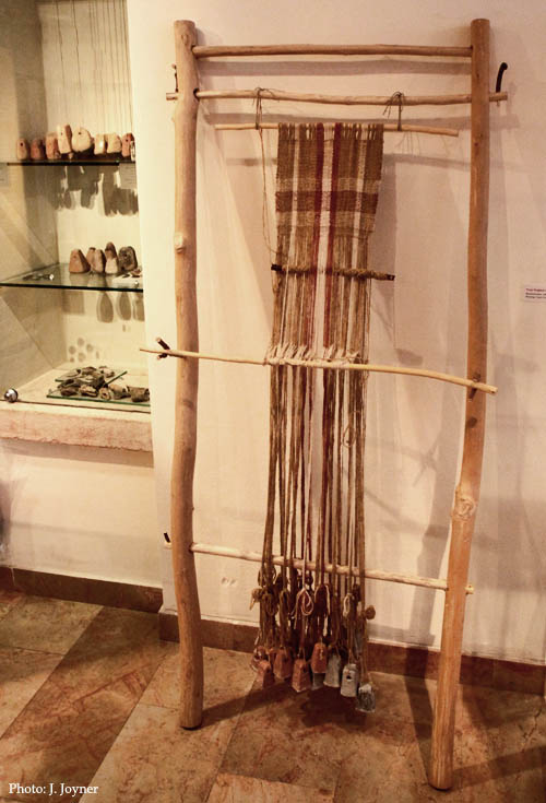 Weaving Loom with weights from Yodefat. Hecht Museum, Haifa. Photo by J. Joyner.