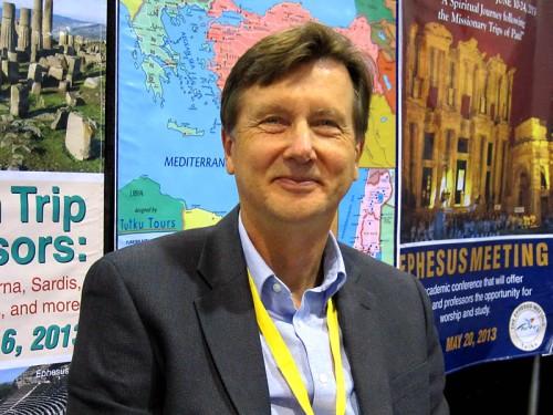 Mark Wilson mans the Tutku Travel booth.