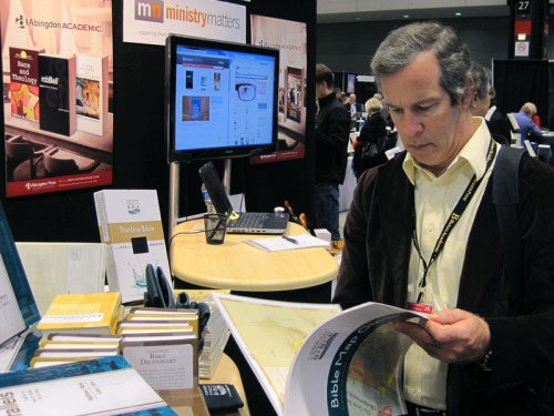 Dr. David McClister looks over a map book at AAR/SBL 2012. Photo by Ferrell Jenkins.