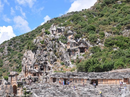 Rock tombs of Myra with Theater in the foreground. Photo by Ferrell Jenkins.