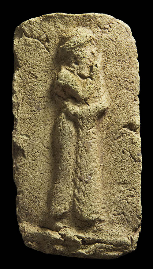 One of the most striking finds to date is a clay plaque, 9cm high, showing a worshiper approaching a sacred place. Photo by Prof. Stuart Campbell, University of Manchester.