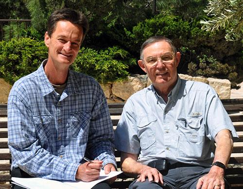 Bill Schlegel autographs a copy of The Satellite Bible Atlas for Ferrell Jenkins.