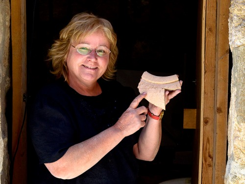 Dr. Eilat Mazar with Canaanite inscription.