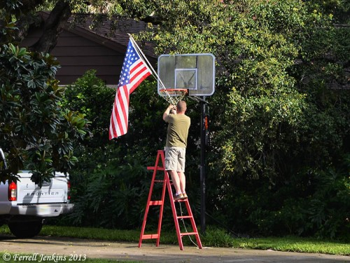 A veteran puts up his flag on July 4th. Photo by Ferrell Jenkins.