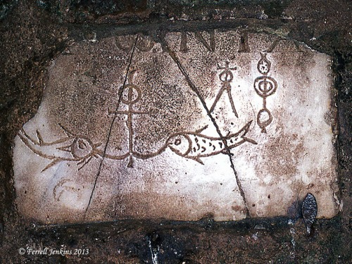 Marker in one of the catacombs. Note symbols of anchor and fish. Photo by Ferrell Jenkins, 1973.