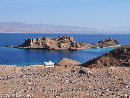View of Pharaoh's Island from the west. The view looks east across the Gulf of Eilat/Aqabah. The land in the distance is Saudi Arabia, the Biblical land of Midian. Photo by Ferrell Jenkins.