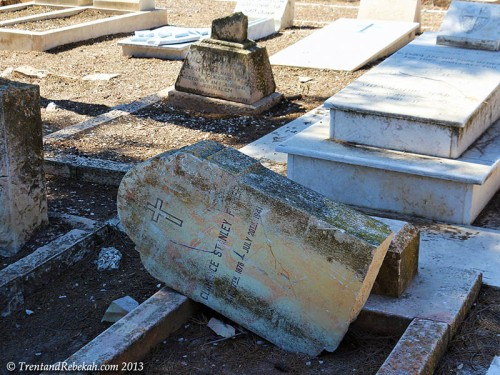 Tomb of Clarence Fisher vandalized in Protestant Cemetery.