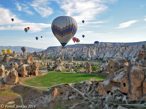 Hot air balloons are moved by the wind over the lunar-like landscape of Cappadocia while the pilots control their altitude. Photo by Ferrell Jenkins.