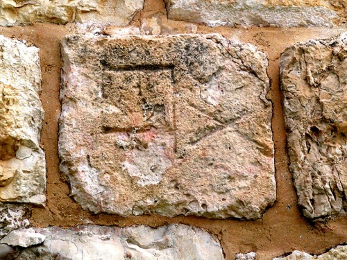 Partial stone bearing inscription of the Tenth Legion reused in the wall of the Old City near Jaffa Gate. Photo by Tom Powers.