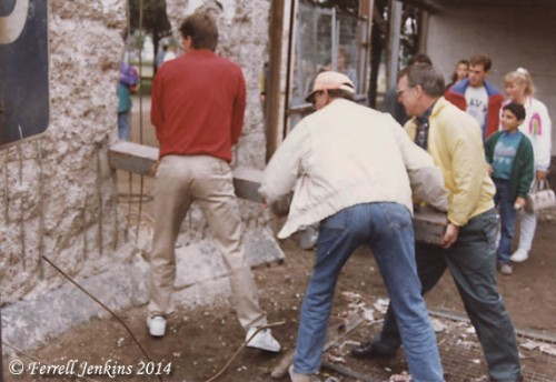 American tourist use a concrete post to dry to break through the Berlin Wall. Photo by Ferrell Jenkins.