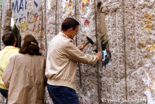 Trying to chisel a piece of the Berlin Wall in 1990.