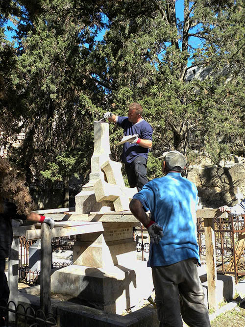 Restoring damaged tomb stones in the Protestant Cemetery.