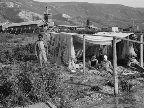 Girls of Ain Geb, a Jewish settlement on the east side of the Sea of Galilee. Girls of the settlement mending fishing nets. Photo: Eric Matson collection LOC.