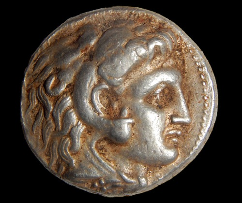A coin of Alexander of Macedon that was part of the silver cache. Photographic credit: Shmuel Magal, courtesy of the Israel Antiquities Authority.