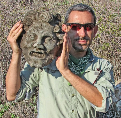 Dr. Michael Eisenberg, University of Haifa, holding the Pan mask discovered at Hippos-Sussita.