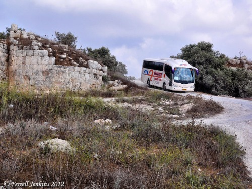 Tourist bus leaving Samaria by the old Roman street. Photo by Ferrell Jenkins.