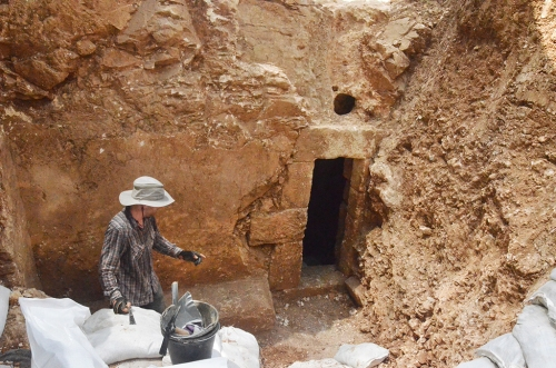 The entrance to the cave when discovered during an inspection by the Israel Antiquities Authority, prior to the construction of a neighborhood nursery school. Photo by Shai Halevy, courtesy of the IAA.