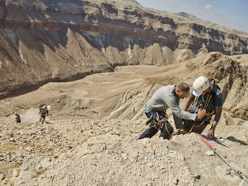 Access to the cave is complicated and for safety's sake requires the use of rappelling equipment. Photographic credit: Yoli Shwartz, courtesy of the Israel Antiquities Authority.
