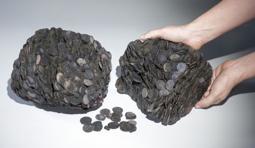 Lumps of coins that were discovered at sea, weighing a total of c. 20 kilograms. Photographic credit: Clara Amit, courtesy of the Israel Antiquities Authority.