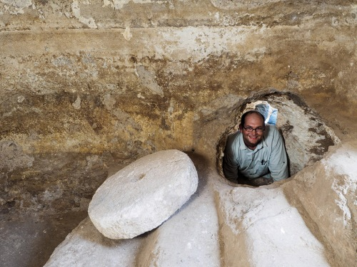 Abraham Tendler, the excavation director, inside a hiding refuge that was connected to a ritual bath (miqwe) during the Bar Kokhba uprising. Photographic credit: Assaf Peretz, courtesy of the Israel Antiquities Authority.