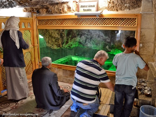 Men worship in the Cave of Abraham at Urfa. Photo by Ferrell