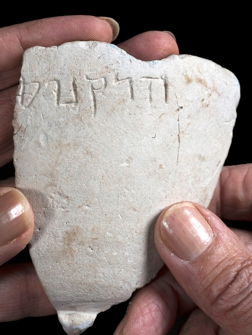 "A fragment of the chalk bowl from the Hasmonean period, which is engraved with the name ""Hyrcanus"". Photo credit: Clara Amit, Israel Antiquities Authority."