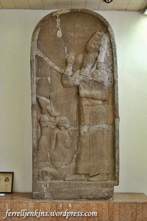 A broken relief showing Esarhaddon with two captured rulers, one on bended knee, before him. Photo by Ferrell Jenkins.