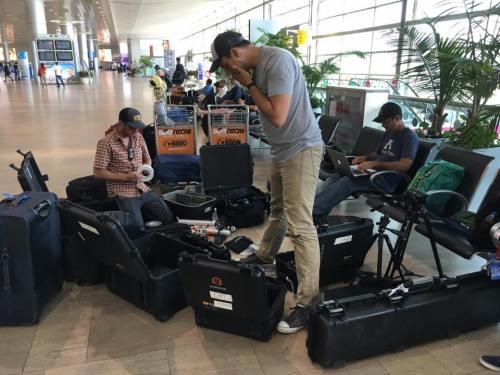 The Appian Media film crew gets ready for an international flight.