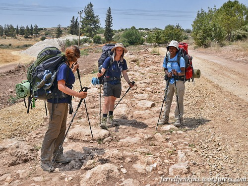 Three young ladies take a break from hiking while standing on the Roman Road. Photo by Ferrell Jenkins.