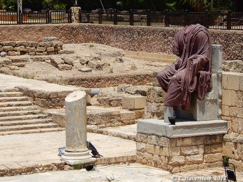 A headless porphyry statue thought to be that of Emperor Hadrian displayed at Caesarea Maritima. Photo by Larry Haverstock.