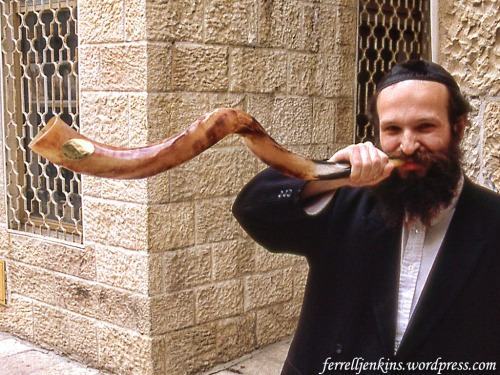Shofar sounded by a shopkeeper in the Jewish Quarter, Jerusalem. Photo by Ferrell Jenkins 1993.