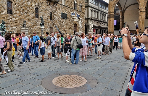 Tourists in Florence, Italy, seem to walk around the plaque marking the site where Savonarola was martyred. Photo by Ferrell Jenkins.