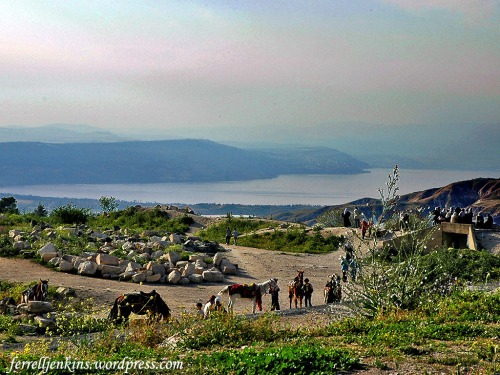 View of the Sea of Galilee in the late afternoon from Umm Qais (Gadara). Notice the slight red sky showing through the haze. Photo by Ferrell Jenkins.