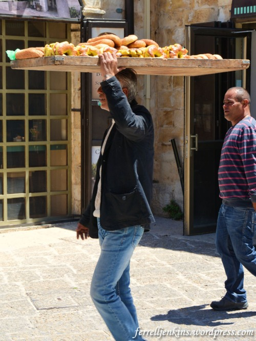 Man carrying bread on his head in the Muristan area of the Old City of Jerusalem. Photo by Ferrell Jenkins.