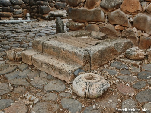 According to Avraham Biran this is where a judge or king could site under his canopy. The stone base, one of four, was used to hold one of the posts of the canopy. Photo by Ferrell Jenkins.