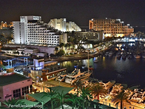 The resort hotels of Eilat are brightly lit at night. Photo by Ferrell Jenkins.