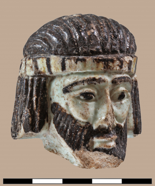Faience head of a king discovered at Abel Beth Maacah in northern Israel. Photo released by Azusa Pacific University.