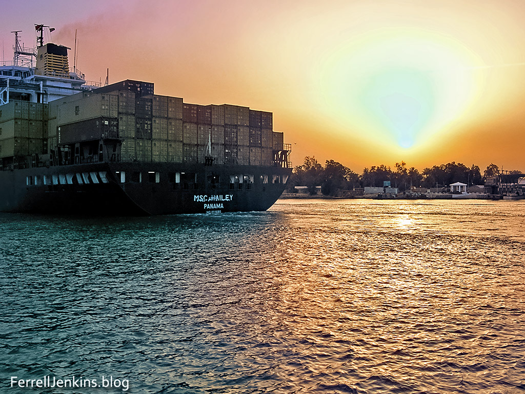 Ship in Suez Canal at sunset. Photo: ferrelljenkins.blog.